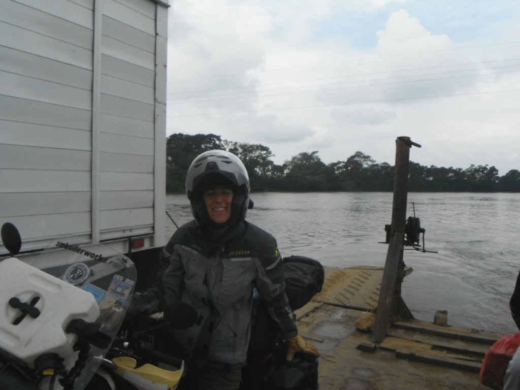 River crossing on a funky ferry powered by an outboard motor.
