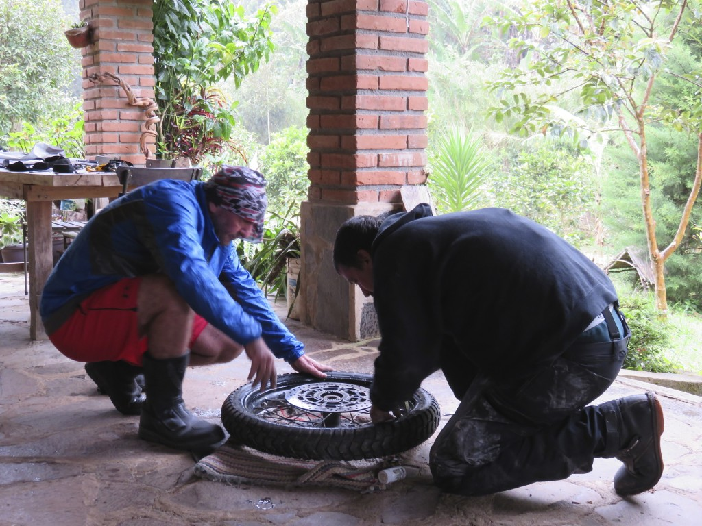 Tire repair on the porch and out of the rain.