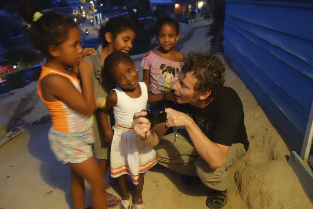 The neighborhood children loved seeing their pictures on Clinton's digital camera.