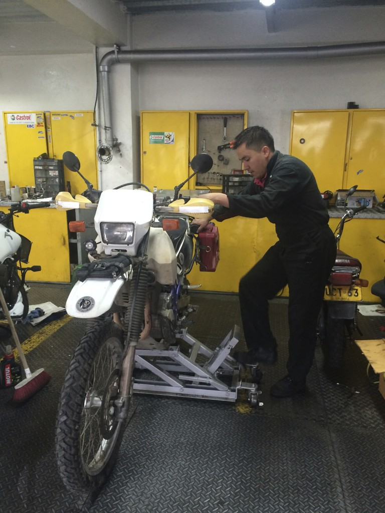 Zippy in good hands. These mechanics also repair the Suzuki DR 650s for the Bogota Police.