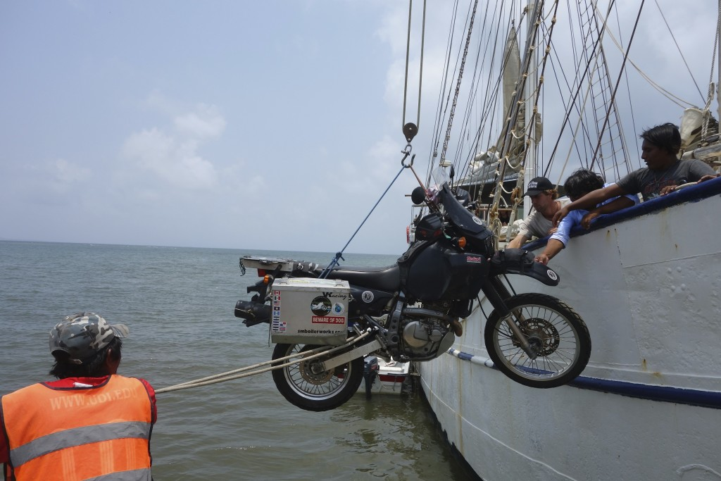 Not very graceful but effective, the yard arm is rigged over the pier and the Black Donkey is cherry picked and soon airborne over the Caribbean. Captain Ludwig has done this many times over the years and made quick work of loading the bikes.