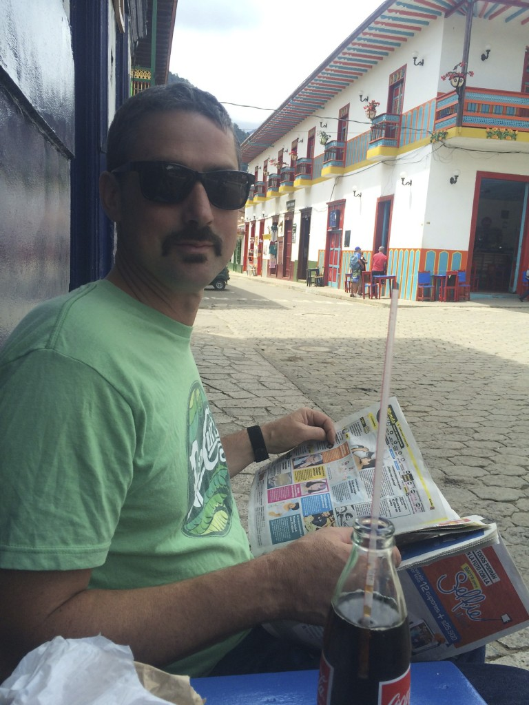 Mike enjoying a coke while reading the want ads in Spanish.