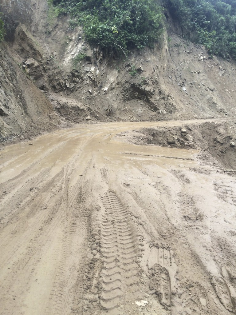 On the road to the Peruvian border, not only was the mud from landslides deep and thick, the thousand foot sheer drop did not make the driving any easier.