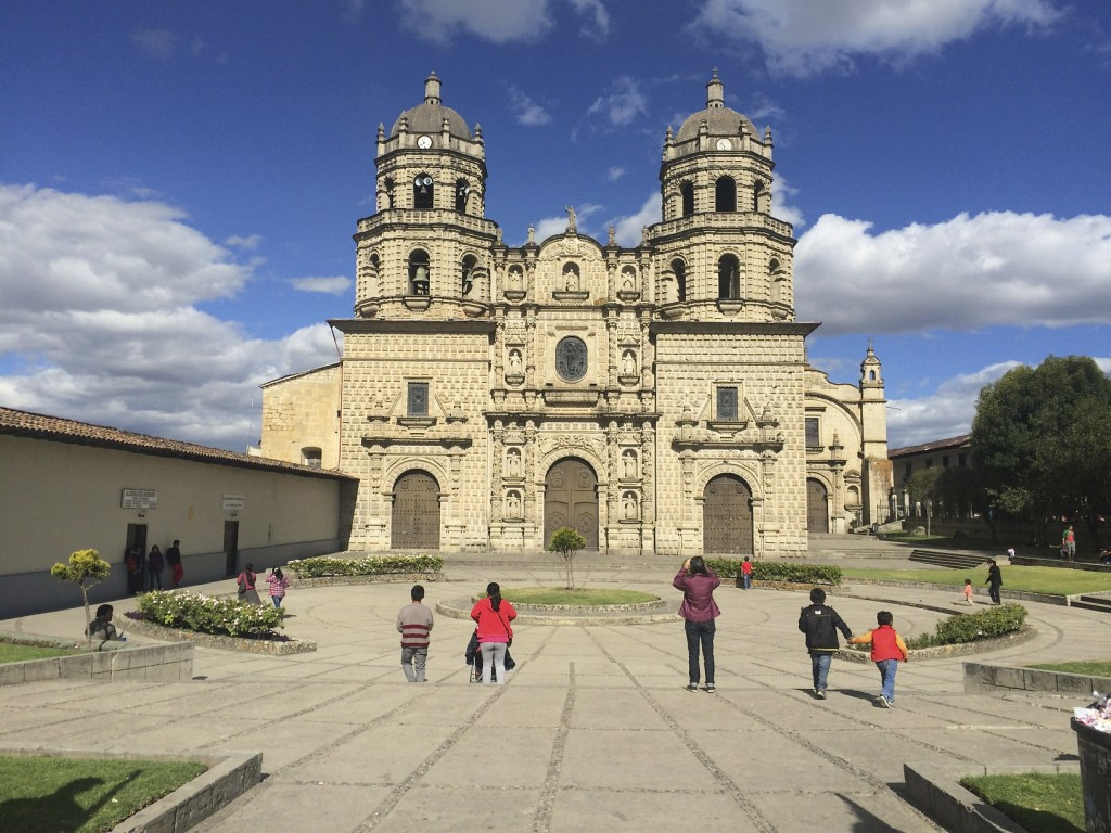 Shannon (in purple coat) snapping pics of the cathedral. Cajamarca, Peru.