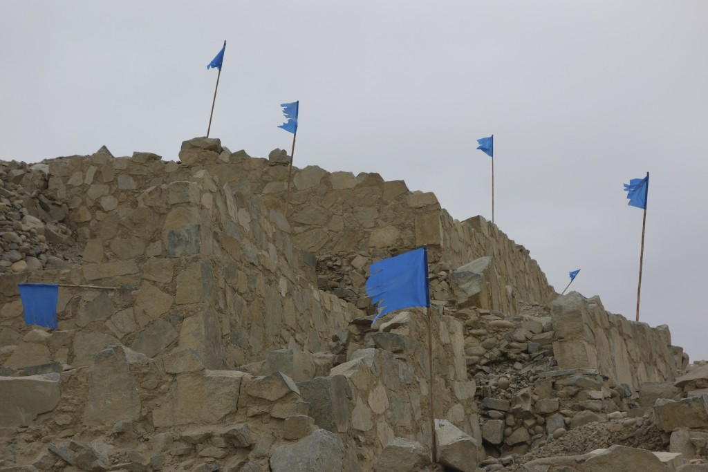 We couldn't figure out why there were blue flags and our Spanish wasn't good enough to get an answer from the our guide. Sacred City of Caral.