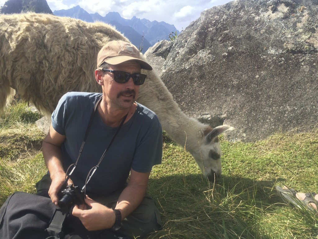 Mike was a bit worried with the llama behind him..he heard they will spit if they get mad. What makes a llama mad?