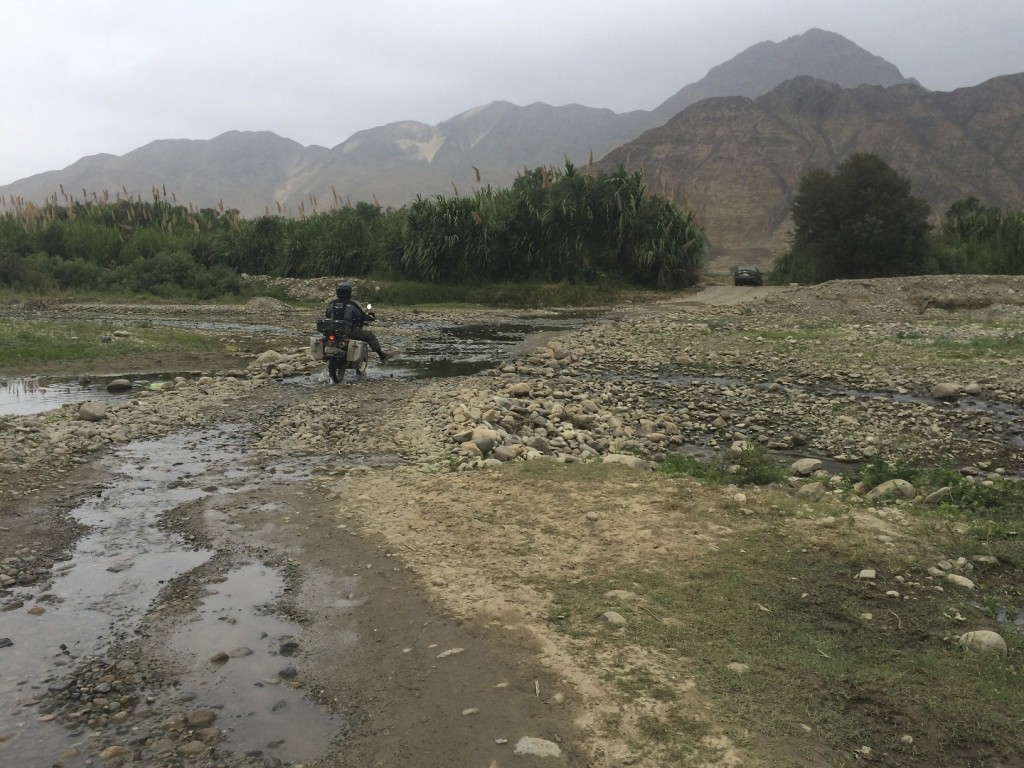 """On the road to our campsite we had to cross a baby river but it was still a challenge keeping the """"go to town"""" shoes dry. Caral Ruins, Peru."""