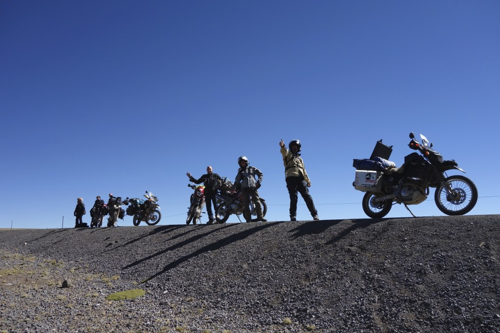 On the road to Cusco, the gang takes a moment to catch our collective breaths in the rarified air at 15,000 feet.