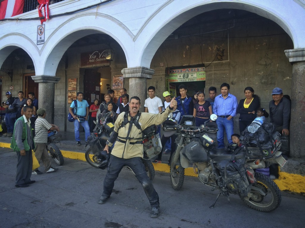 Overland motorcyclists are a fascination to Peruvians and friendly crowds often gather to hear stories about travel and marvel at the strange machines we ride. Ayacucho, Peru.