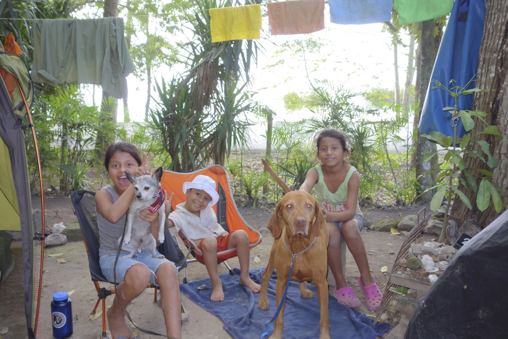 Camp chairs and dogs are a siren song for children in every country. Our camp near Tikal in northern Guatemala was no exception.