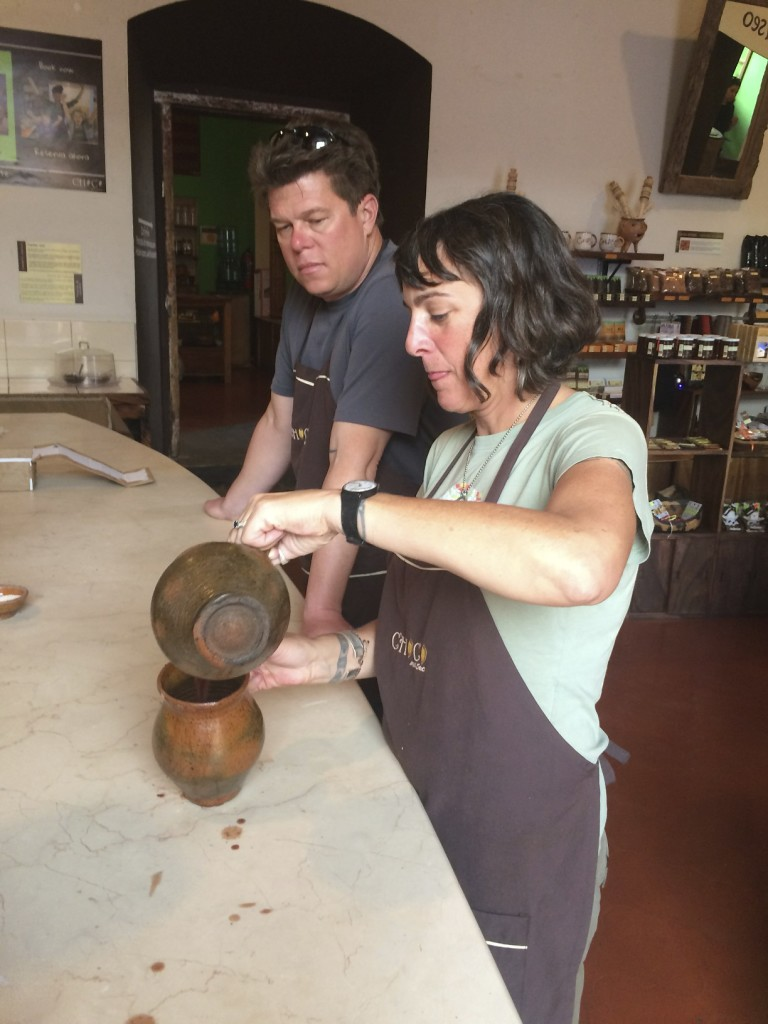 David lived in the house next to ours in Antigua, Guatemala and we talked him into taking a chocolate making class with us. Here Shannon perfects the art of making the royal drink of the Mayans.