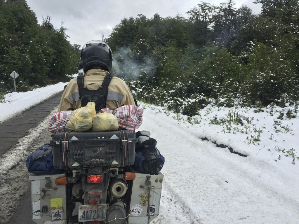 The snow that had us pinned down on Rio Ibanez was ridable on our way out due to the convoy of cars and trucks that blasted through the snow ahead of us. As long as we stayed in the wheel tracks it was doable.