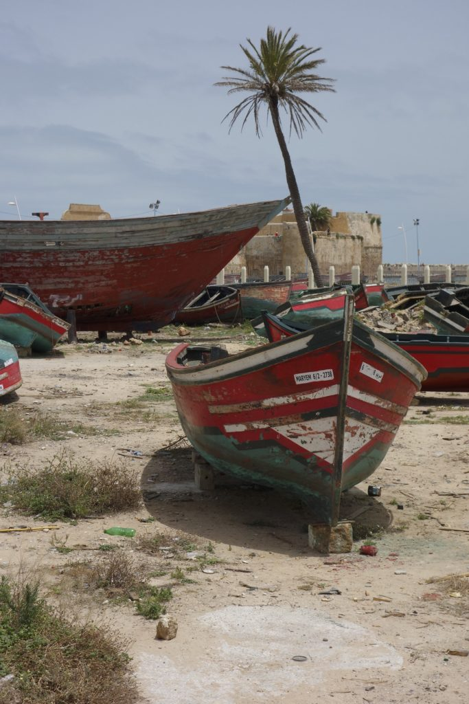 Behind the fishing boats out for repair is the old Portuguese enclave at the port of El Jadida, Morocco.