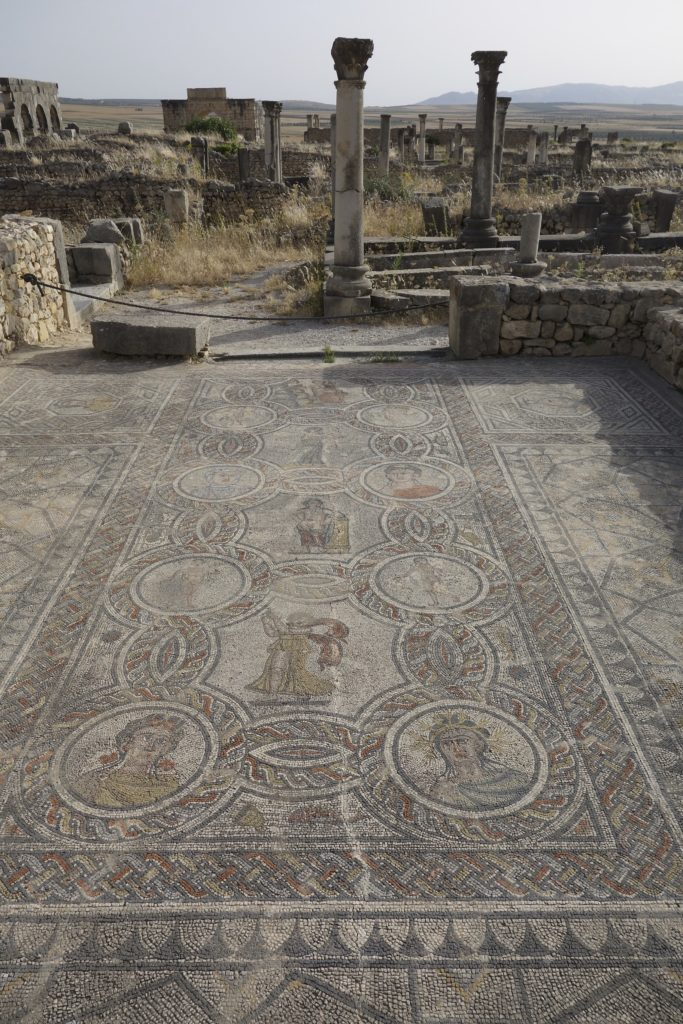Many of the mosaic floors at Volubilis remain intact. Depictions of Roman life, legends and art were captured in these tile floors. Many are over 2000 year old and, exposed to the sun and weather, it is amazing that they are still here.