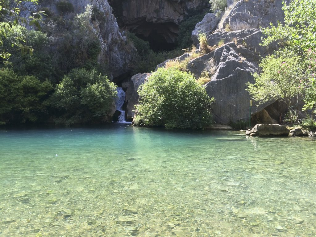 It was a very hot day when we visited the Cueva del Gato. The water coming out of the cave was pure and ice cold making the air around the pond much cooler than the surrounding countryside. Benaojan, Spain.