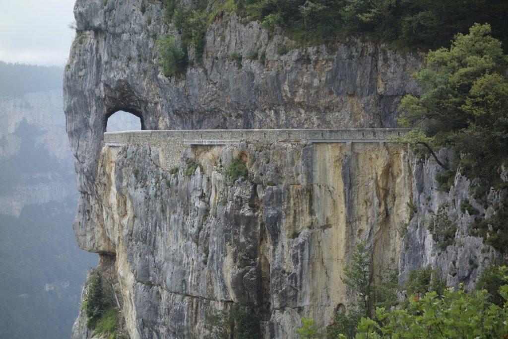 French roads through the Alps can be hair raising rides. La Combe Laval dans le massif du Vercors, France.