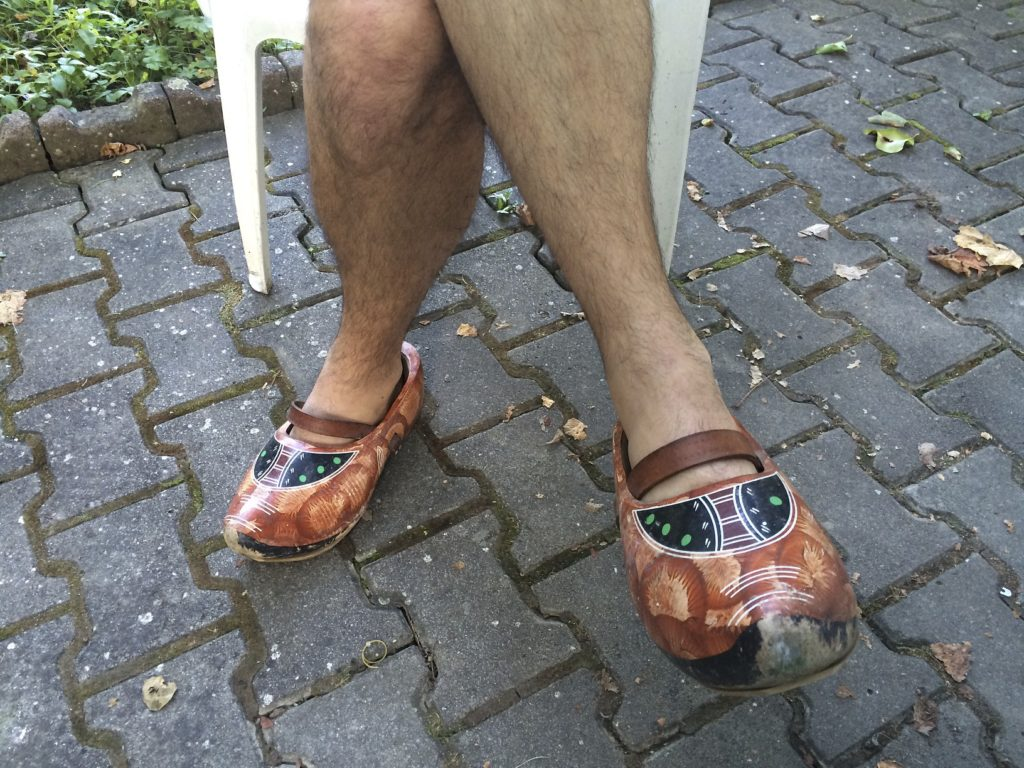 I always thought Dutch wooden shoes were a relic from the past, until I met Hans in Romania, who wears them everyday. He loaned me a pair to try. I opted to keep my motorcycle boots instead, fewer slivers.
