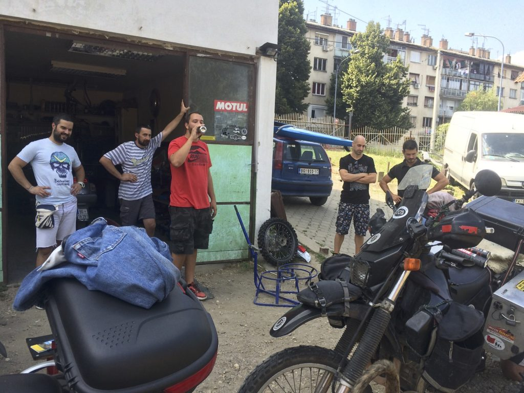 It is the same the world over, one guy fixes his bike and all his buddies stand around and give helpful pointers. I am changing a rear tire in this picture with plenty of help standing by. Belgrade, Serbia.
