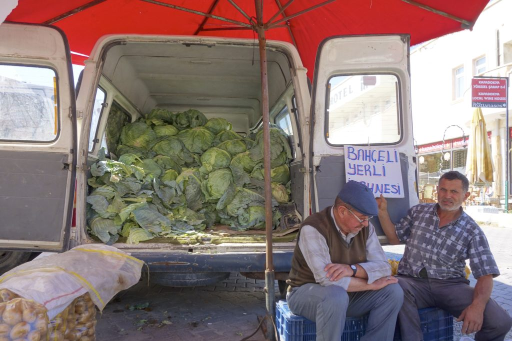 Some mighty cabbages for sale in Cappadocia. The farmer wanted to make sure his sign made it in the photo. Göreme, Turkey.