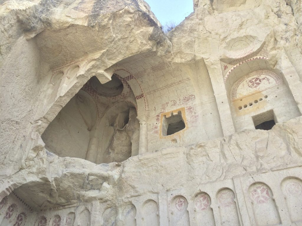 The remains of a Christian church carved into the hillside. The amount of caves and voids carved by humans in the region is countless and new discoveries are still being made. Göreme, Turkey.