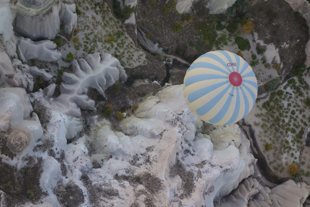 A colorful sea anemone on the the coral reef?  Nope, the top of a hot air ballon passing over the eroded hills of Cappadocia.