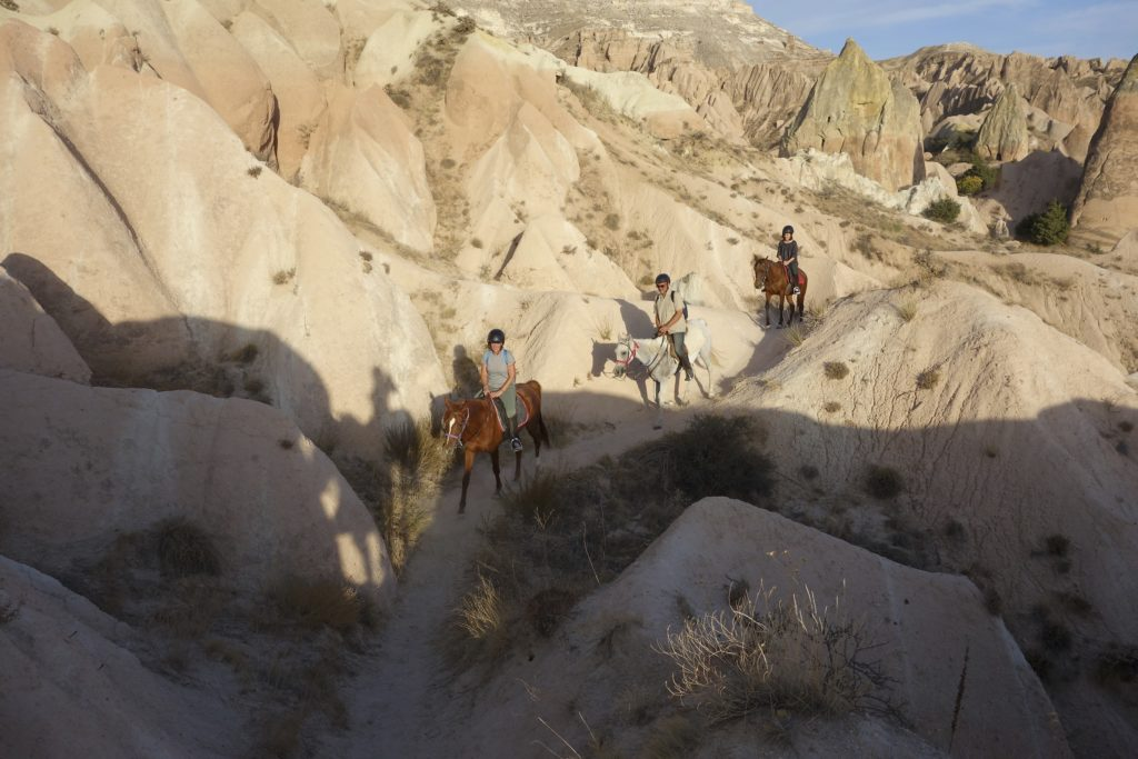 The Rose Valley at sunset is the perfect place for a horseback trip into the backcountry. Göreme, Turkey.